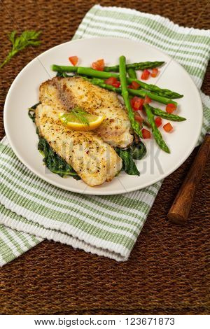 Baked Tilapia Fish Fillet with Asparagus. Selective focus.
