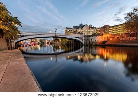 Reflection of Lendal bridge in still water of River Ouse York England.
