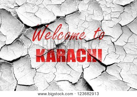 Grunge cracked Welcome to karachi with some smooth lines