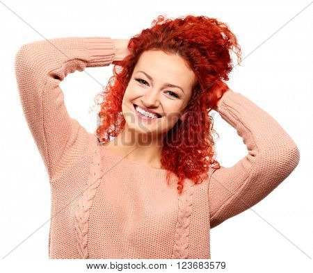 Happy red-haired young woman, isolated on white