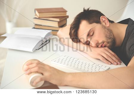 Young man fell asleep during reading.