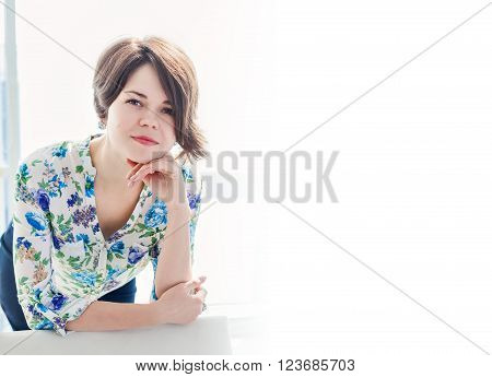 Portrait of a young woman psychologist practitioner in a bright office with copy space. Consulting psychologist in the office. A positive solution to the problems.
