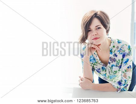 Portrait of a young woman psychologist practitioner in a bright office with copy space. A positive solution to the problems. Consulting psychologist in the office.