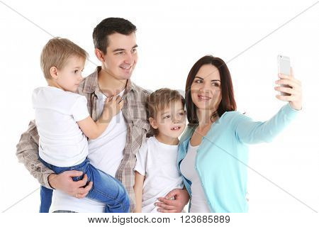 Happy family making selfie with mobile phone isolated on white