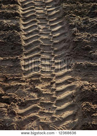 The trace of a tyre in the sand