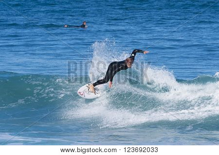 Torquay, Australia - Nov 22, 2015: People surfing at a beach along the Great Ocean Road in Australia