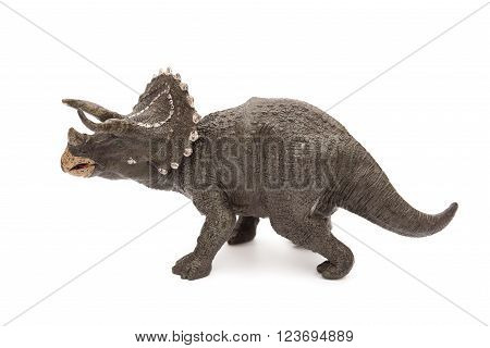 side view grey triceratops toy on a white background