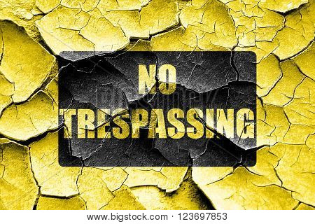 Grunge cracked No trespassing sign with black and yellow colors