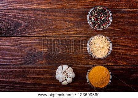 Aromatic spices on wooden background. Food ingradients. poster