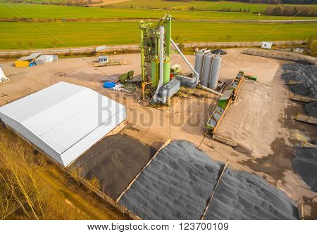 Aerial view to tarmacadam plant near new highway construction. Industrial landscape in Czech Republic, Europe.