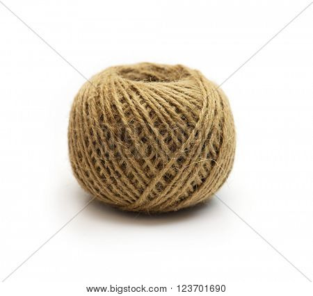 Tightly wound ball of hemp string, isolated on white, Shallow depth of field.