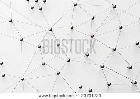 Linking entities. Network, networking, social media, connectivity, internet communication abstract. Top view. Web of thin silver wires on white background.