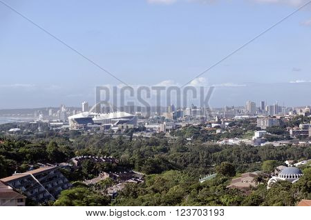 DURBAN SOUTH AFRICA - MARCH 12 2016: Above view of residential housing and city skyline and Moses Mabhida stadium in Durban South Africa