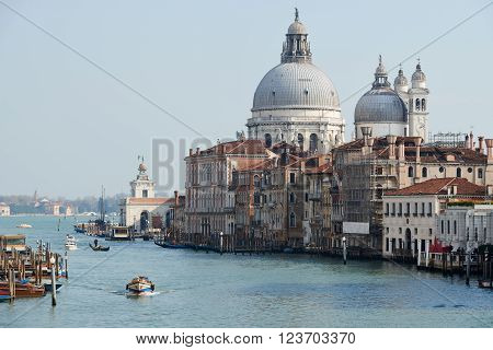 Venice, Italy - Febuary 19, 2016: Basilica di Santa Maria della Salute (Saint Mary of Health) a Roman Chatholic church and minor basilica located in the Dorsoduro sestiere in Venice a city in northeastern italy.