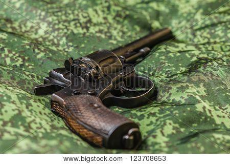 Vintage generic russian soviet 9mm pistol on pixel camouflage background