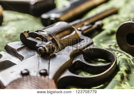 Detail shot of vintage generic russian soviet 9mm pistol on pixel camouflage background