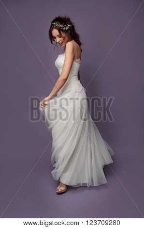 Adorable young bride with brown curly hair blue eyes and white dress and pearl headpiece with bare shoulders ** Note: Soft Focus at 100%, best at smaller sizes