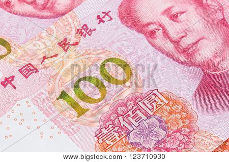 Closeup of the new 100 RMB bill with focus on the yellow green 100 number