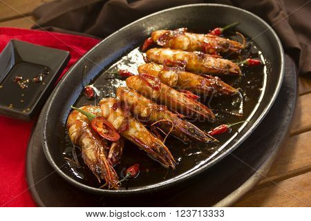 Delicious Asian style shrimps on a hot cast iron pan.