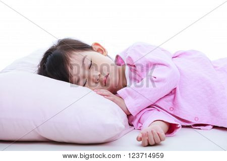 Healthy children concept. Close up of little asian child sleeping peacefully. Adorable girl in pink pajamas taking a nap. On white background.