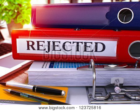 Red Office Folder with Inscription Rejected on Office Desktop with Office Supplies and Modern Laptop. Rejected Business Concept on Blurred Background. Rejected - Toned Image. 3D.