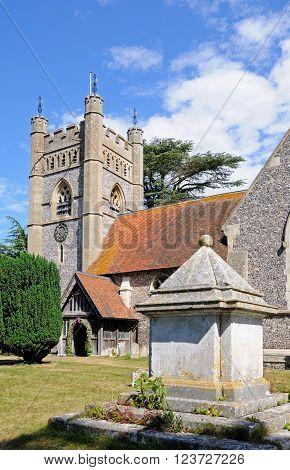 HAMBLEDON, UK - JULY 10, 2015 - St Marys church and churchyard in the village centre Hambledon Oxfordshire England UK Western Europe, July 10, 2015.