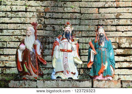 Three Goddesses Fu Lu Shou (Chinese Luck Symbol) on brick wall