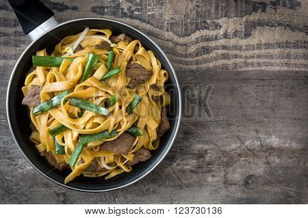 Beef chow mein in a frying pan. Chinese food