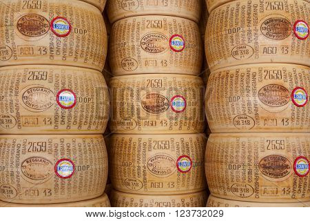 BRA, ITALY - SEPTEMBER 18, 2015: Wheels of Parmesan - famous italian hard cheese made from raw cow's milk, often grated over dishes and named after producing areas near Parma, Italy.