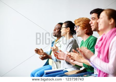 Students clapping hands
