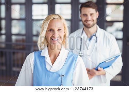 Portrait of cheerful doctors standing in hospital