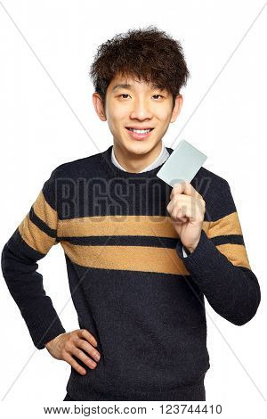 Asian young man holding card on white background
