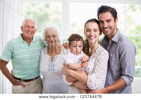 Portrait of happy family with baby at home