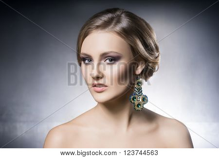 Portrait of beautiful girl in shiny jewels.