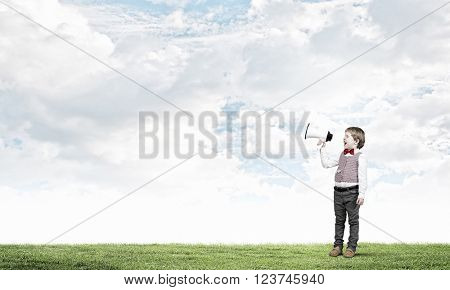 Kid boy with megaphone