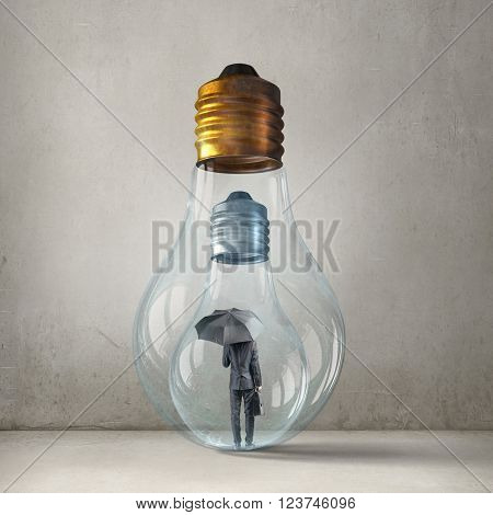 Businessman in electric bulb