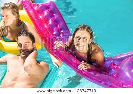 Happy friends enjoying their day together in the swimming pool