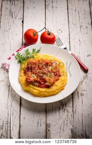 cod with tomato sauce and porridge