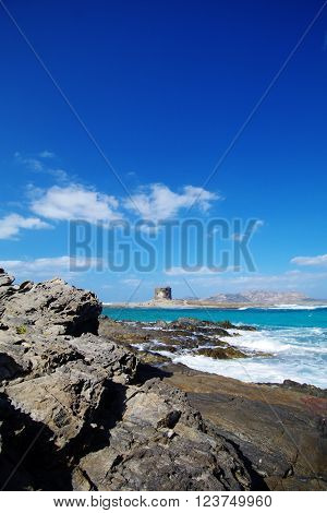 A lone watchtower breaks the horizon in this Mediterranean panorama from Sardinia, Italy.