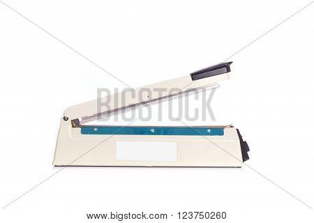 Close up plastic bag sealer isolated on white background