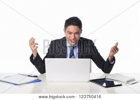 Portrait of smile handsome business man working with laptop with his hands raised