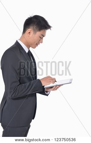 Portrait of young businessman Using Digital Tablet Isolated