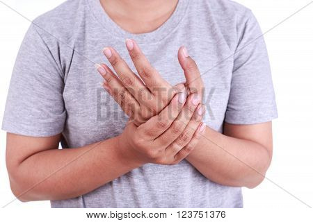Close up woman's holding her hand isolated on white background. Hand pain concept.