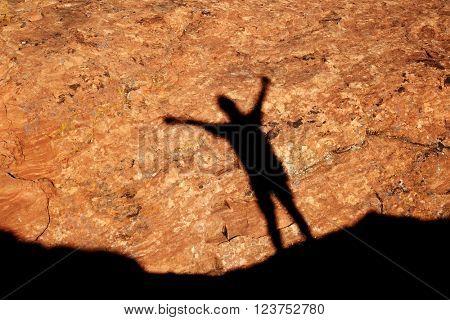 Single girl climbing along rocky ridge on a trail