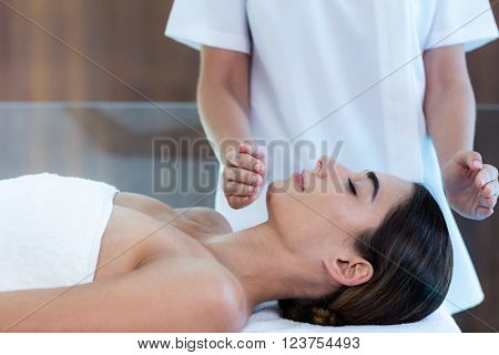 Woman receiving massage from masseur at spa