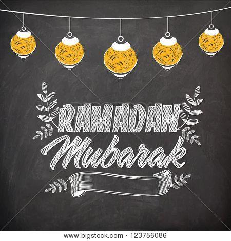 Stylish text Ramadan Mubarak with hanging lanterns created by chalk on blackboard background for Holy Month of Muslim Community celebration.