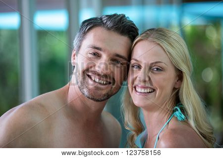 Portrait of happy couple near pool