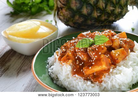 Chicken in caribbean style with pineapple and rice