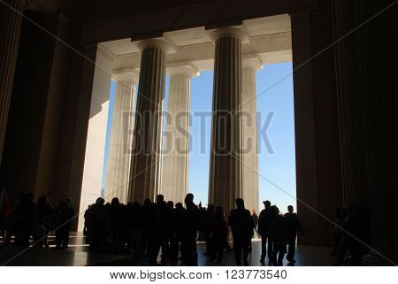 Tourists Silhouetted Inside the Lincoln Memorial in Washington D.C.