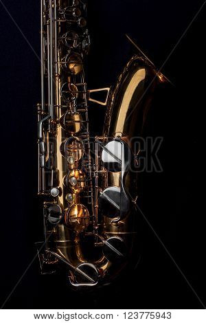 Tenor Saxophone isolated on a black background.